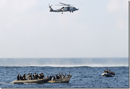 Via the Boston Globe's Big Picture blog - Search and seizure team members from the guided-missile cruiser USS Vella Gulf close in to apprehend suspected pirates in the Gulf of Aden February 12, 2009. (Jason R. Zalasky/AFP/Getty Images)