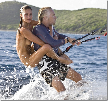 Hitching a ride: Model Denni Parkinson clings to Sir Richard Branson off the coast of his private Caribbean island, Necker