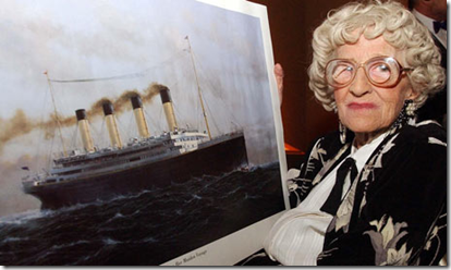 Millvina Dean, the last living survivor of the Titanic disaster, with a painting of the vessel. Photograph: John Stillwell/AP