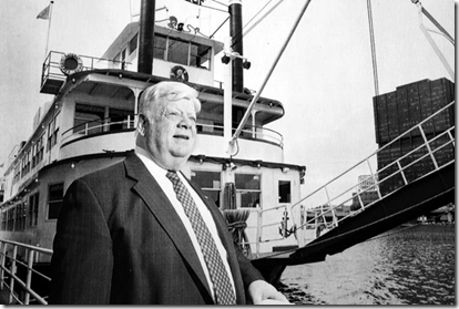 John Connelly, in this 1994 photo, poses at his Gateway Clipper Fleet's Monongahela River dock in Pittsburgh. His budding fleet of excursion vessels in Pittsburgh eventually grew to include a 1,000-seat boat. AP photo