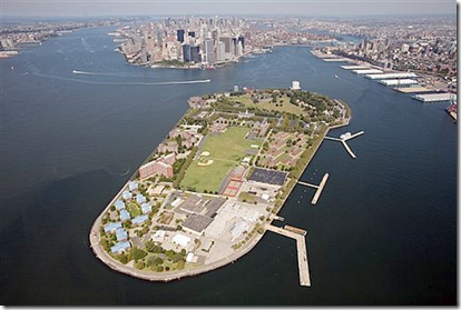 This Sept. 8, 2008 file aerial photo shows Governors Island in New York harbor, with Manhattan in the background center. The Urban Assembly New York Harbor School will relocate to a renovated Coast Guard hospital on the island in the fall of 2010.(AP Photo/Mark Lennihan, file)